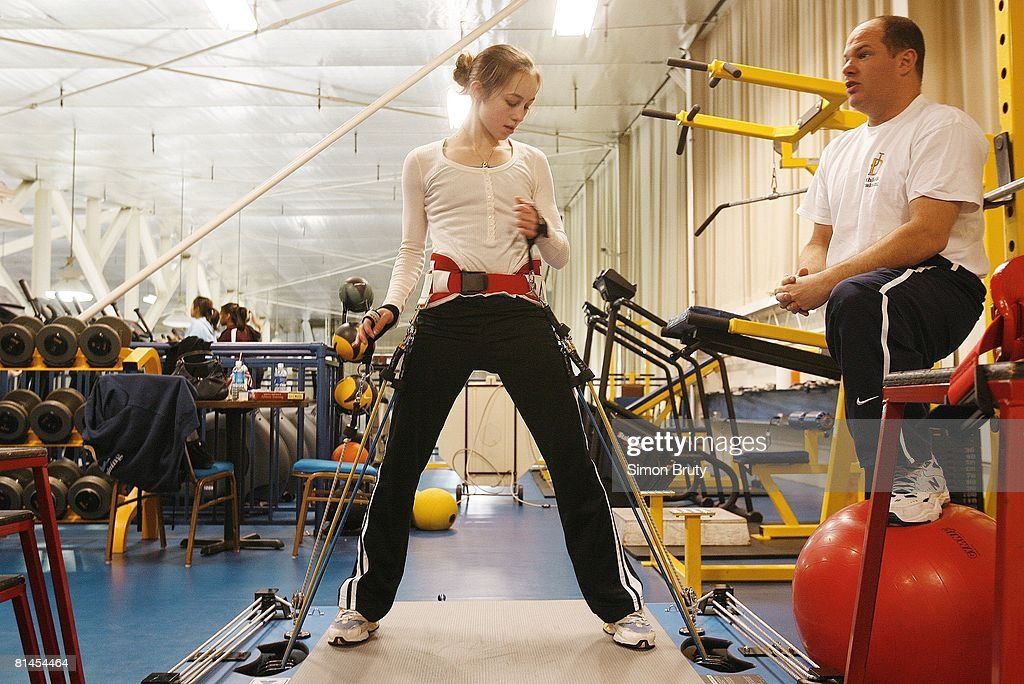 Figure Skating USA Olympic athlete Kimmie Meissner working out on Vertimax machine at University of Delaware Newark DE 1/27/2006