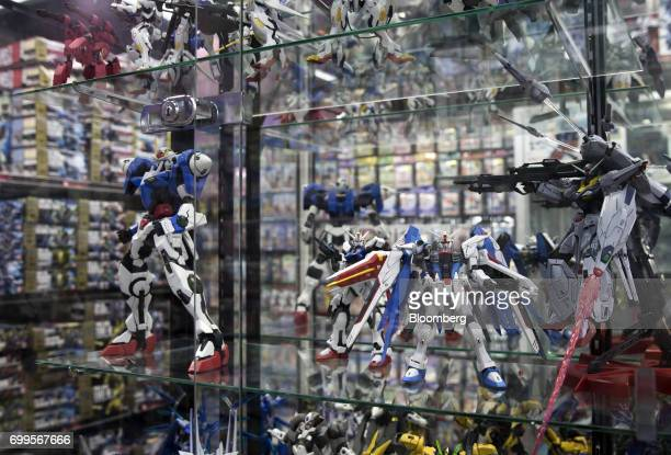 Figures from the Mobile Suit Gundam series animation are displayed at the Sofmap Akiba electronics store operated by Bic Camera Inc in the Akihabara...