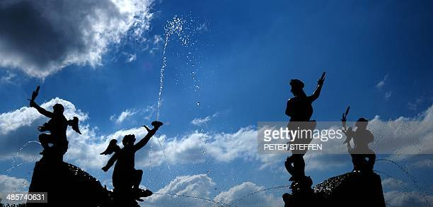 Figures of a fountain spout water at the Herrenhaeuser Gaerten garden in Hanover central Germany on April 20 2014 AFP PHOTO / PETER STEFFEN / GERMANY...