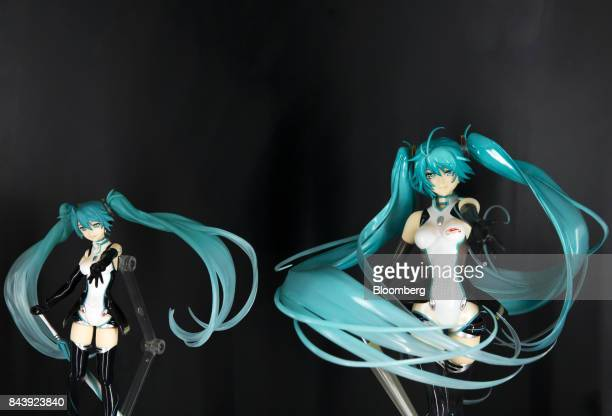 Figures of Hatsune Miku a virtual pop star and the voice behind Crypton Future Media Inc's vocal synthesizer softwarestand on display during the...