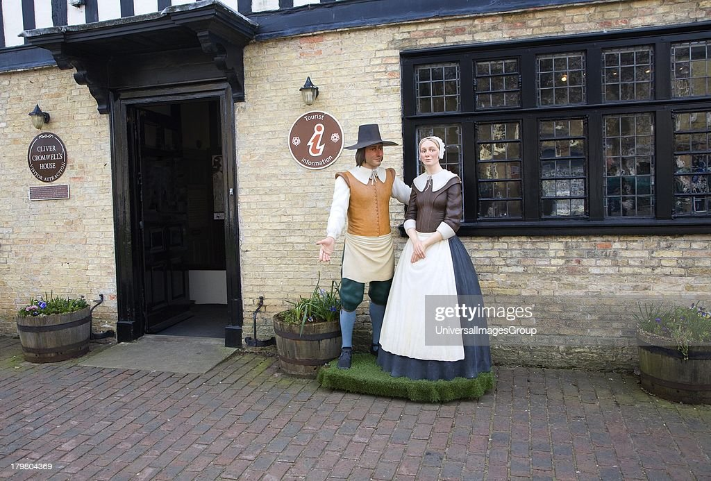 Figures of man and woman outside Oliver Cromwell house in Ely Cambridgeshire England