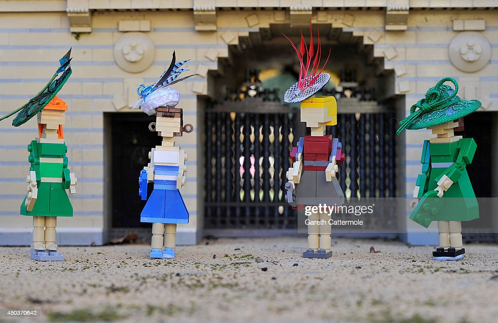 LEGO figures of Princess Beatrice, Princess Eugenie, Zara Tindall and Carole Middleton stand outside a LEGO Buckingham Palace wearing designer hats by Rachel Trevor-Morgan, The Queen's milliner ahead of Royal Ascot at LEGOLAND Windsor on June 10, 2014 in Windsor, England.