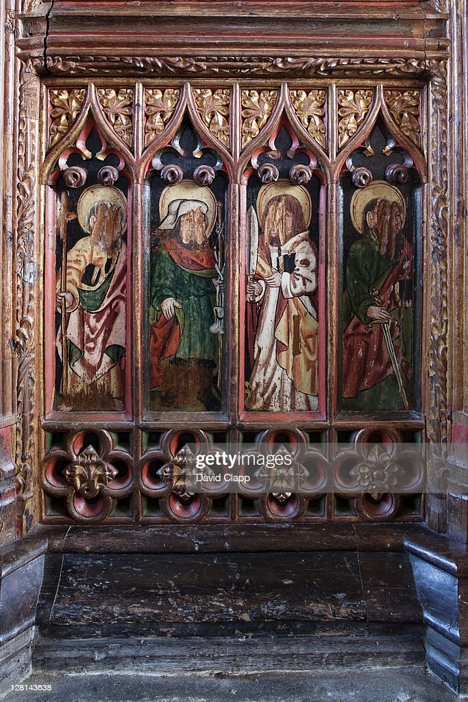 Figures of saints and other holy figures with faces scratched out during the reformation in 1548, St Winifred Church, Manaton, Dartmoor, Devon, England, UK