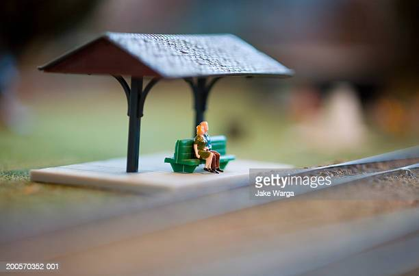 Figures on model railway platform