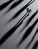 Figurine Businessman crowded by shadows