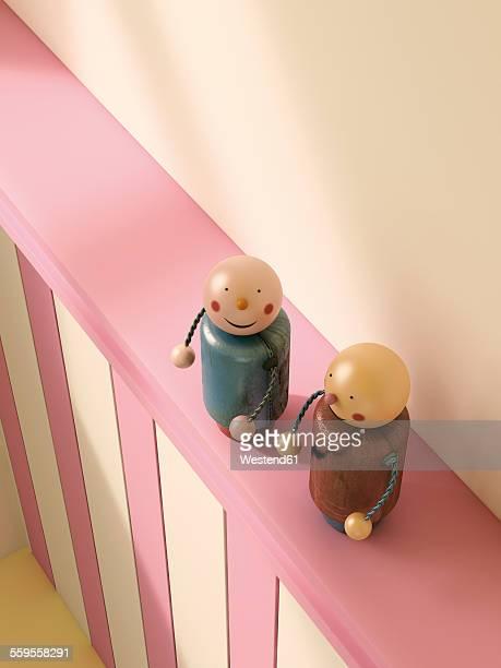 Figurine couple standing on ledge