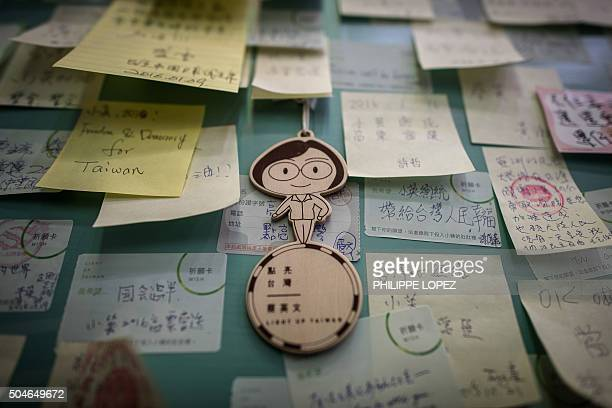 A figurine depicting Democratic Progressive Party presidential candidate Tsai Ingwen hangs with messages of support in Taipei on January 12 2016...