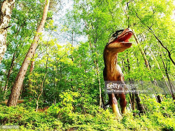 Figurine Dinosaur In Forest