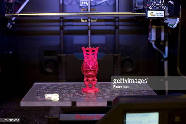 A figurine is constructed in a Makerbot Industries LLC Replicator 2 Desktop 3D Printer at the company's new factory in the Brooklyn borough of New...