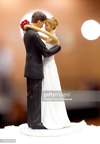 A figurine of a bride and a groom sits atop a wedding cake during an election party at the North Raleigh Hilton on Tuesday May 8 2012 Organizers plan...