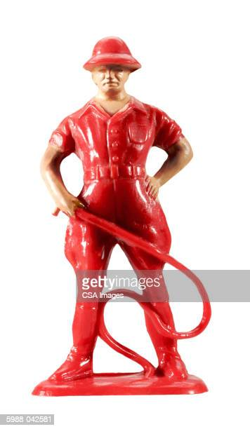 Figurine of Man Holding Whip