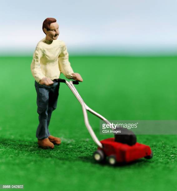 Figurine of Man Mowing Lawn