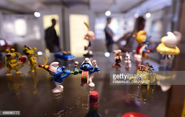Figurines of characters from the Belgian comic series 'The Smurfs' created by Belgian cartoonist Peyo are displayed in the 'Centre Belge de la Bande...