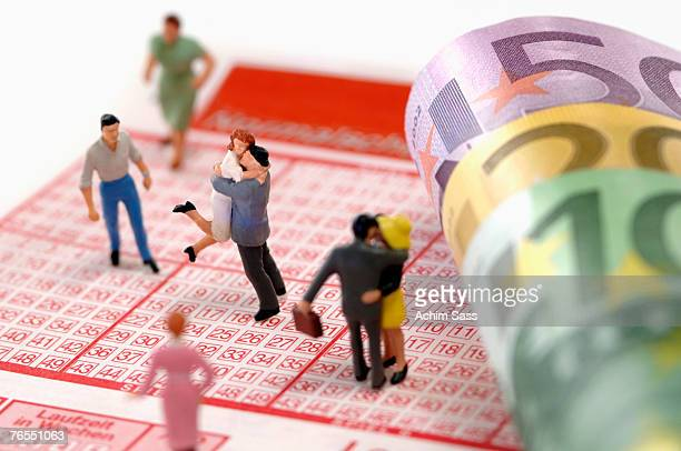Figurines on lottery coupon, elevated view, close-up