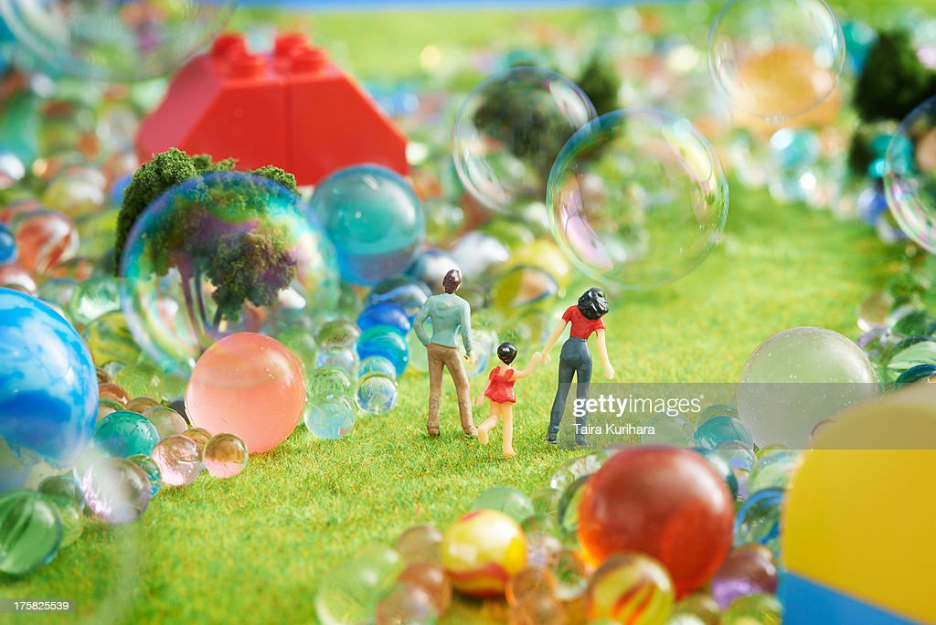 Figurines pretend grass with marbles