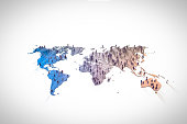 figurines standing on continents in world map