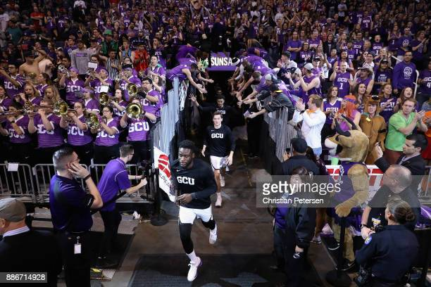 Fiifi Aidoo of the Grand Canyon Antelopes leads teamamtes onto the court before the college basketball game against the St John's Red Storm at...