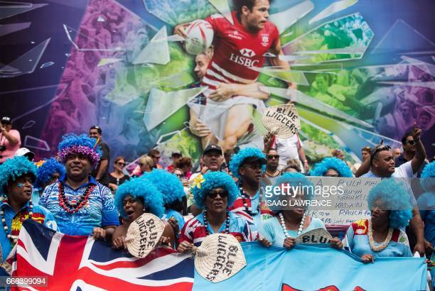 Fiji fans cheer on their team during the third day of the Hong Kong Rugby Sevens Tournament on April 9 2017 / AFP PHOTO / ISAAC LAWRENCE