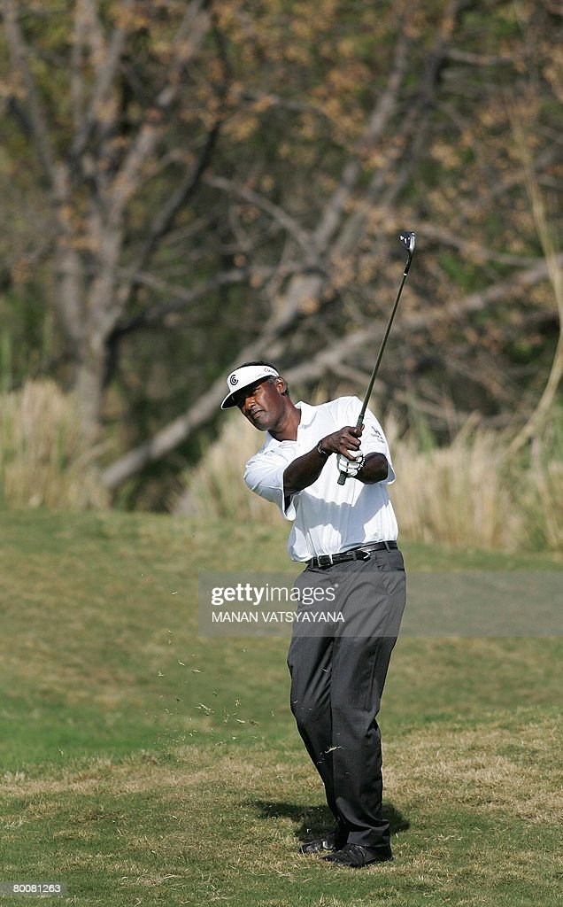 Fiji golfer Vijay Singh drives the ball on the fifteenth green during the final round of the Johnnie Walker Classic 2008 in Gurgaon on the outskirts...
