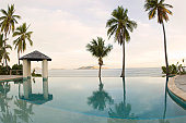 Fiji, Mamanuca Islands, Mana Island, infinity pool and sea at dawn