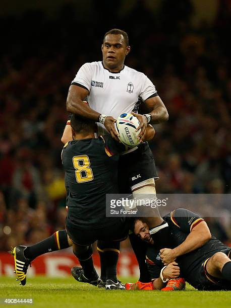 Fiji player Leone Nakarawa is stopped by Taulupe Faletau and Scott Baldwin of Wales during the 2015 Rugby World Cup Pool A match between Wales and...