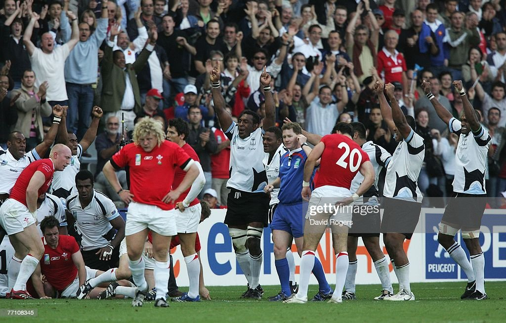 Fiji players celebrate their team's 3834 victory as the final whistle blows during the Rugby World Cup 2007 Pool B match between Wales and Fiji at...