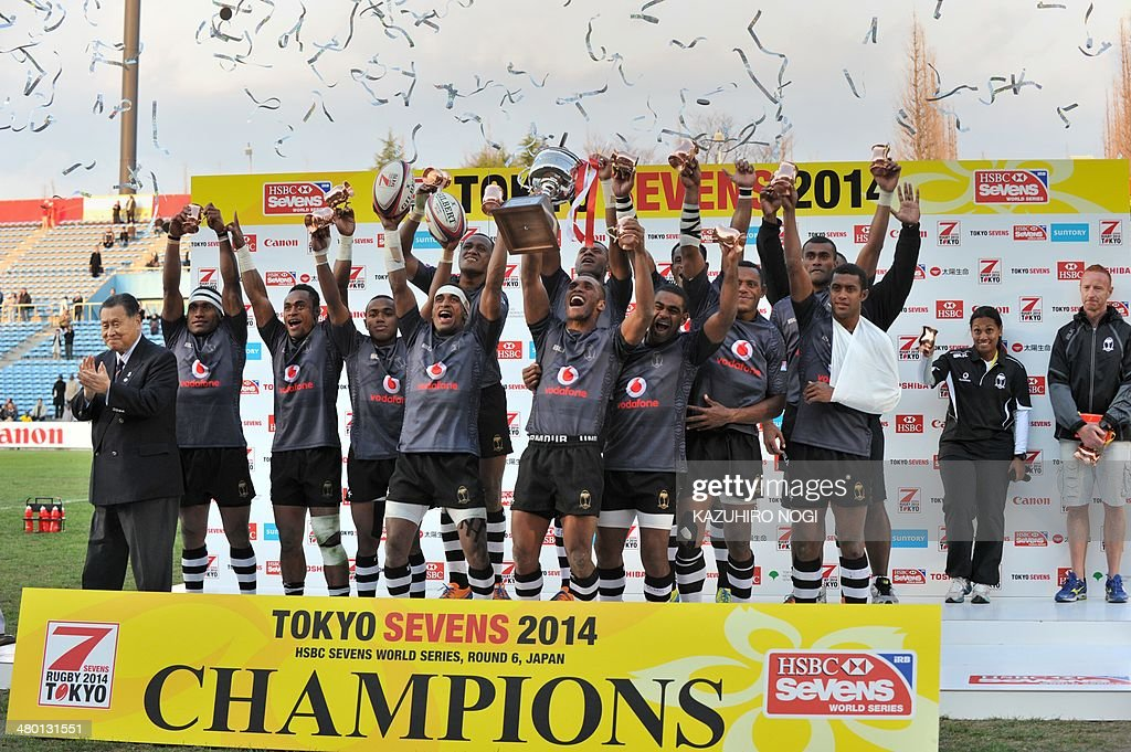 Fiji players celebrate their win over South Africa during the awards ceremony after the Tokyo Sevens 2014 Cup final match, part of the Rugby Sevens World Series, in Tokyo on March 23, 2014.