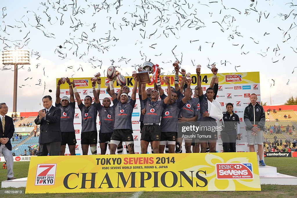 Fiji players celebrate with the trophy after defeating South Africa to win the Cup Final during the Tokyo Sevens, the six round of the HSBC Sevens World Series at the Prince Chichibu Memorial Ground on March 23, 2014 in Tokyo, Japan.