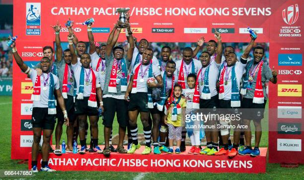 Fiji players celebrate with the trophy after winning the 2017 Hong Kong Sevens final against South Africa at Hong Kong Stadium on April 9 2017 in...