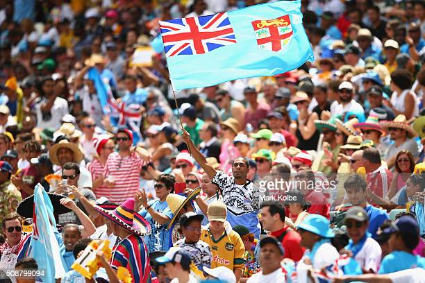 Fiji supporter in the crowd waves a flag during the 2016 Sydney Sevens cup quarter final match between Fiji and Kenya at Allianz Stadium on February...
