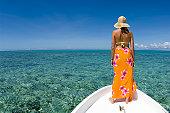Fiji, Vanua Levu Island, woman standing on bow of boat, rear view