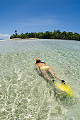 Fiji, Vanua Levu Island, young woman snorkeling, elevated view