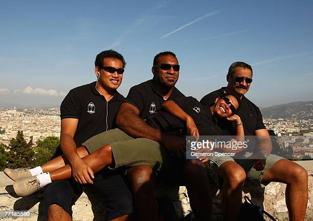 Fiji vicecaptain Kele Leawere poses with team physios at the Basilique NotreDame de la Garde October 4 2007 in Marseille France
