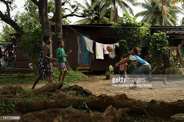 Fijian children play volleyball in front of their makeshift home on the Jitu Estate Settlement in Suva Fiji The estate is home to thousands of...