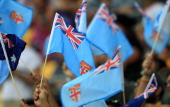 Fijian flags are waved during pool play at the Rugby Sevens tournament in Wellington New Zealand on February 0 2012 AFP PHOTO /MARTY MELVILLE