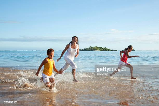 Fijian Mother and Daughters Running on Beach