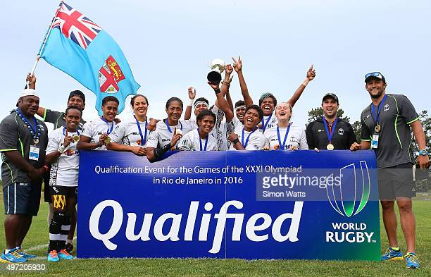 Fijian players celebrate after winnning the World Sevens Oceania Olympic Qualification match Final between Fiji and Samoa on November 15 2015 in...