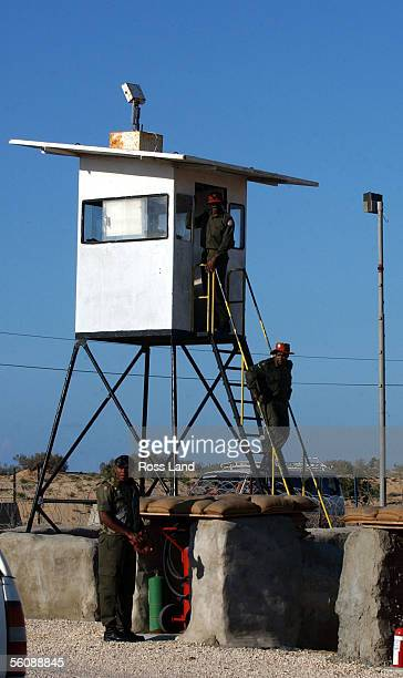 Fijian soldiers of the Multinational Peackeeping Force and Observers patrol from the tower at camp One Bravo as New Zealand Prime minister Helen...