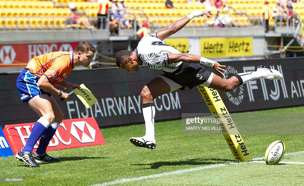 Fiji's Joji Baleviani Raqamate scores a try in front of the touch judge during their Bowl Quarter Final against the US at the Westpac Stadium on day two of the fourth leg of the IRB Rugby Sevens World Series in Wellington on February 2, 2013. AFP PHOTO / Marty MELVILLE