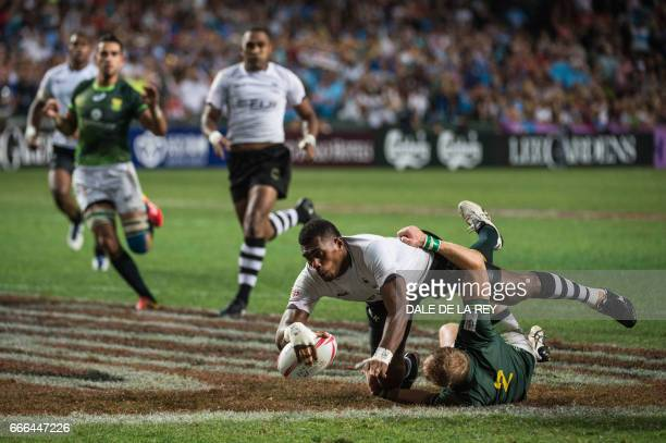 Fiji's Kalione Nasoko is tackled by South Africa's Philip Snyman in the Cup Final on the final day of the Hong Kong Rugby Sevens tournament on April...