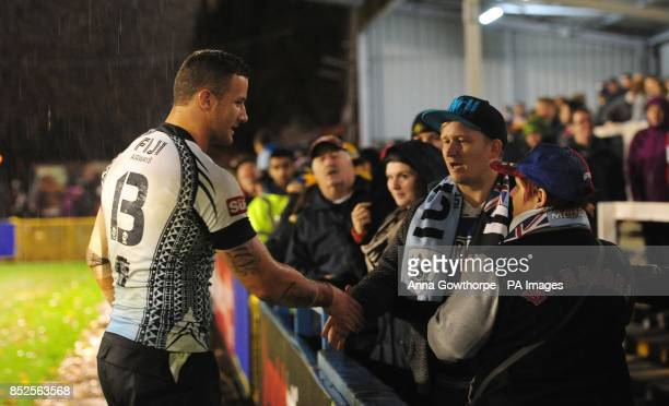 Fiji's Korbin Sims celebrates with fans at the final whistle during the 2013 World Cup match at Spotland Rochdale
