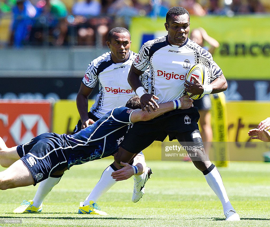Fiji's Manasa Nayagi (R) is tackled by Scotland's Struan Dewar with Fiji's Joji Baleviani Raqamate (rear) in support during their pool D match at the Westpac Stadium on the fourth leg of the IRB Sevens World Series in Wellington on February 1, 2013. AFP PHOTO / Marty MELVILLE