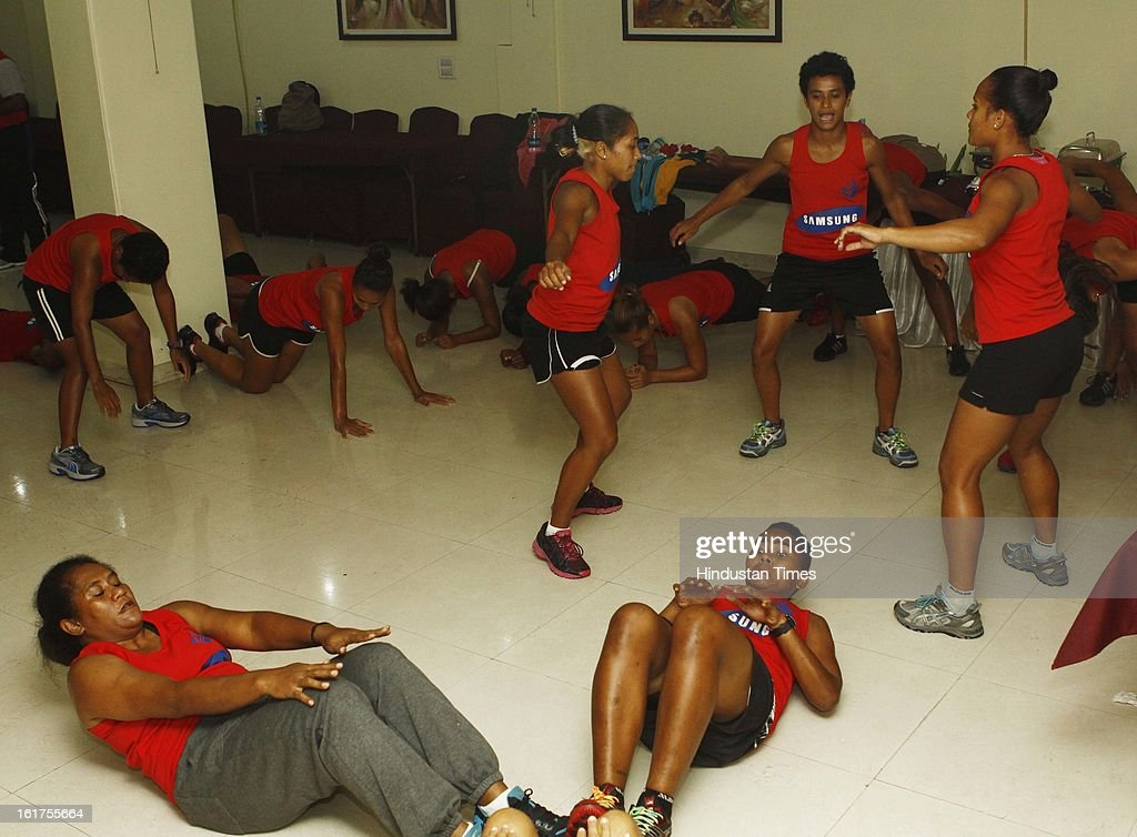 Fiji's Men's and Women's Hockey members doing stretching exercises in a basement of a small hotel where they were staying at Karol Bagh on February 15, 2013 in New Delhi, India. Fiji Hockey team in Delhi to participate in the Hockey World League Round 2 to be played from 18 to 24 Feb here at Major Dhyan Chand Stadium.
