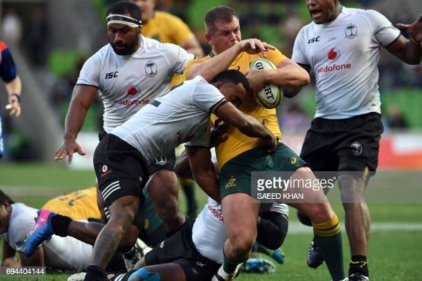 Fiji's Sunia Kota tackles Australia's Toby Smith during the rugby union Test match between Australia and Fiji in Melbourne on June 10 2017 / AFP...