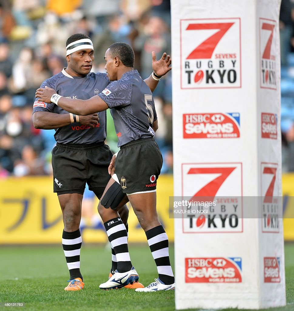 Fiji's Waisea Nacuqu (R) is congratulated by his teammate Leo Naikasau (L) after scoring the winning try against South Africa during their Tokyo Sevens 2014 Cup final match, part of the Rugby Sevens World Series, in Tokyo on March 23, 2014.