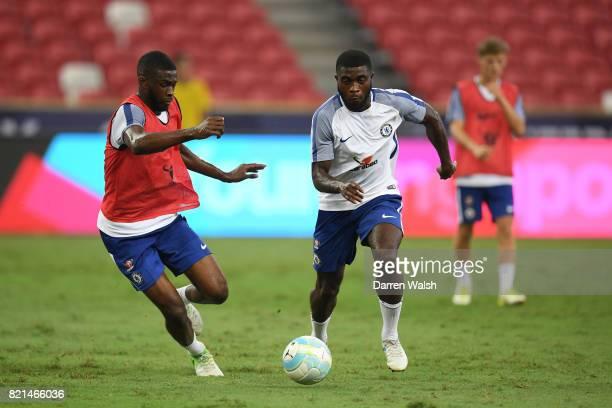 Fikayo Tomori and Jeremie Boga of Chelsea during a training session at Singapore National Stadium on July 24 2017 in Singapore
