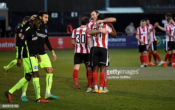 Fikayo Tomori of Brighton and Hove Albion is consoled by his team mates after scoring an own goal while Lincoln City players celebrate their second...
