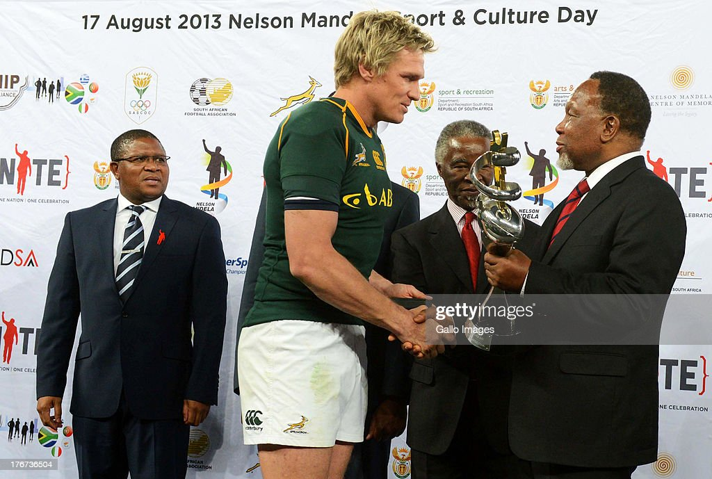 Fikile Mbalula, Jean De Villiers, fomer President Thabo Mbeki and Deputy President Kgalema Motlanthe during the Castle Rugby Championship match between South Africa and Argentina at FNB Stadium on August 17, 2013 in Soweto, South Africa.