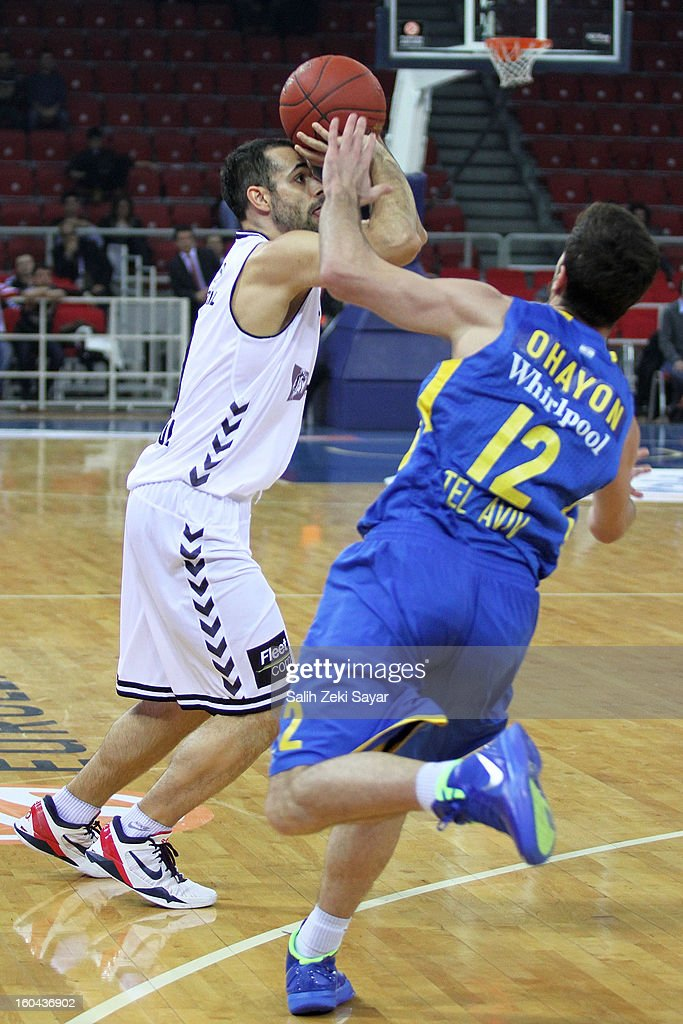 Fikret Can Akin #10 of Besiktas JK Istanbul competes with Yogev Ohayon #12 of Maccabi Electra during the 2012-2013 Turkish Airlines Euroleague Top 16 Date 6 between Besiktas JK Istanbul v Maccabi Electra Tel Aviv at Abdi Ipekci Sports Arena on January 31, 2013 in Istanbul, Turkey.