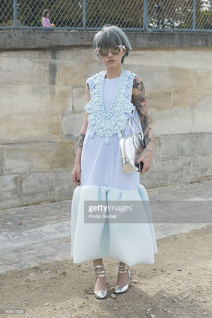 Fil wearing a Li Xiao dress, Dolce and Gabanna sunglasses, Vivienne Westwood shoes and a Comme Des Garcons bag on day 8 of Paris Fashion Week Spring/Summer 2014, Paris October 01, 2013 in Paris, France.